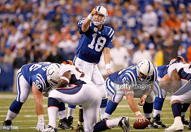 Peyton Manning of the Indianapolis Colts gives instructions to his team at the line of scrimmage during the NFL game against the Denver Broncos at...
