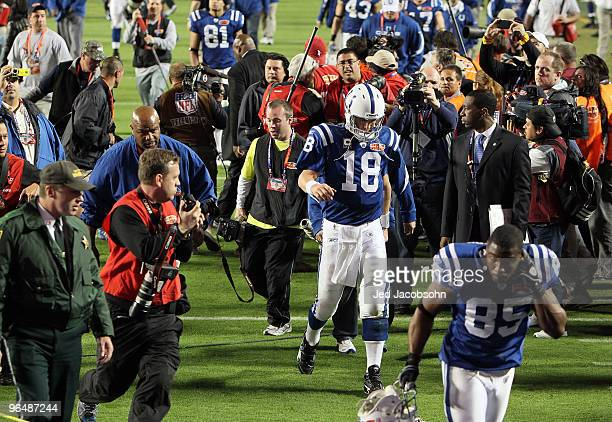 Peyton Manning of the Indianapolis Colts walks off the field after being defeated by the New Orleans Saints during Super Bowl XLIV on February 7 2010...