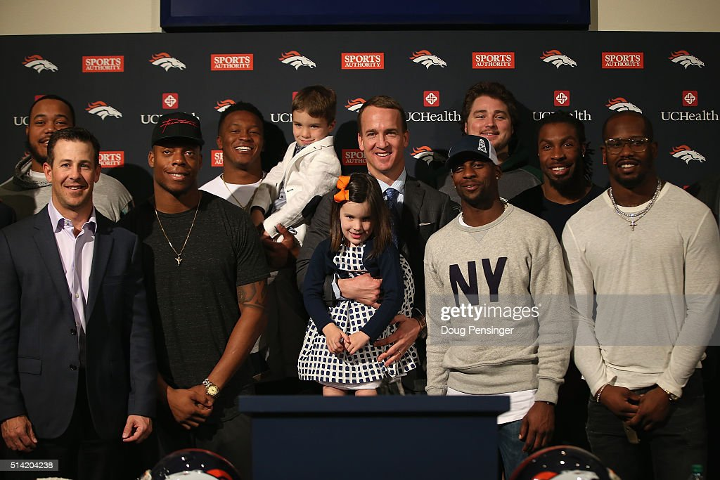 Peyton Manning (C) poses with his daughter Mosley, his son Marshall, and former Denver Broncos teammates including Brandon Stokley, Brandon Marshall, Demaryius Thomas, Ty Sambrailo, Emmanuel Sanders, David Bruton, and Von Miller following his announcment that he is retiring from the NFL at the UCHealth Training Center on March 7, 2016 in Englewood, Colorado. Manning, who played for both the Indianapolis Colts and Denver Broncos in a career which spanned 18 years, is the NFL's all-time leader in passing touchdowns (539), passing yards (71,940) and tied for regular season QB wins (186). Manning played his final game last month as the winning quarterback in Super Bowl 50 in which the Broncos defeated the Carolina Panthers, earning Manning his second Super Bowl title.
