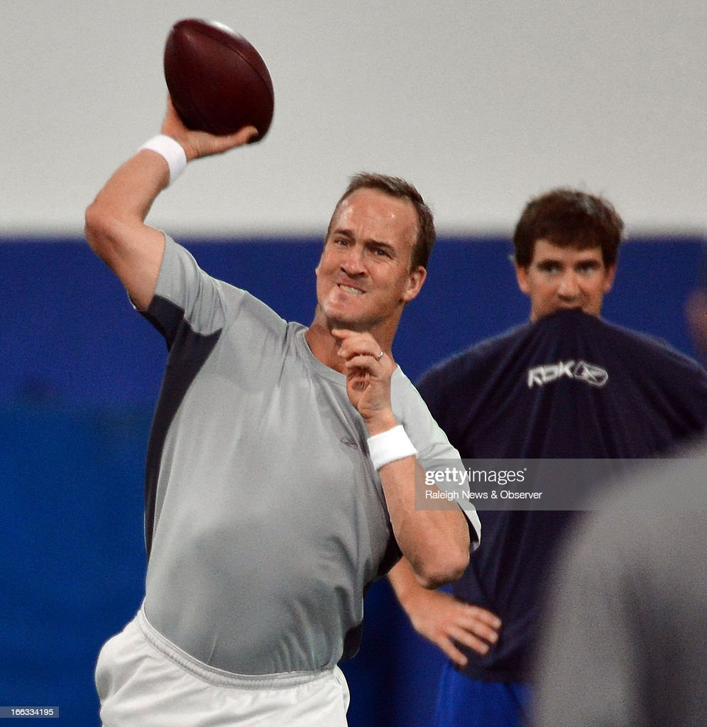 Peyton Manning throws a pass during a workout at Duke's Pascal Field House in Durham, North Carolina, Thursday, April 11, 2013.