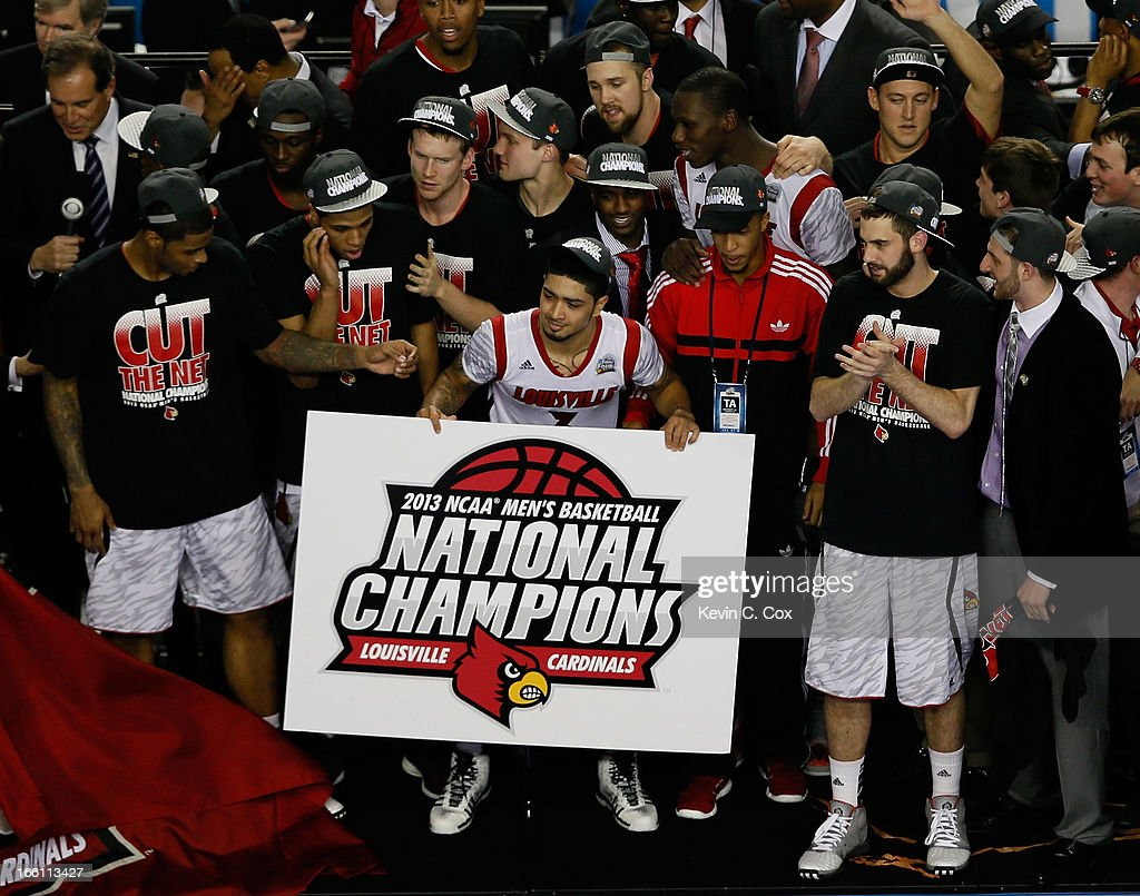 Peyton Siva (C) #3 of the Louisville Cardinals celebrates with his teammates after they won 82-76 against the Michigan Wolverines during the 2013 NCAA Men's Final Four Championship at the Georgia Dome on April 8, 2013 in Atlanta, Georgia.