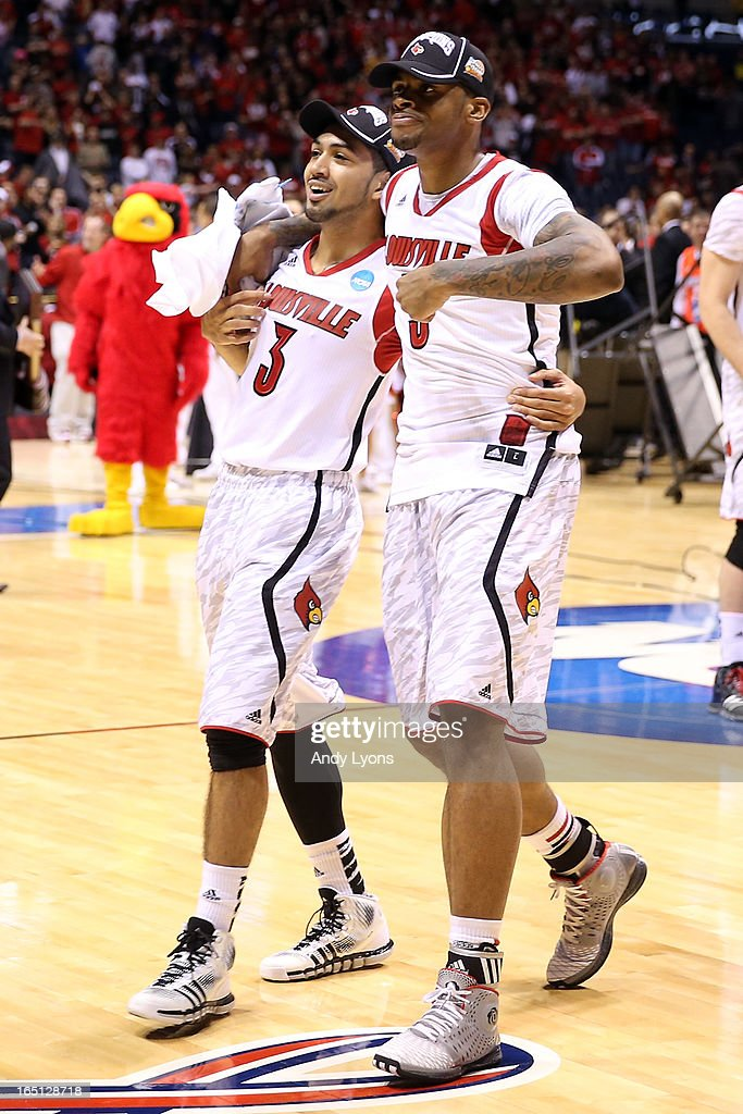 Peyton Siva #3 and Chane Behanan #21 of the Louisville Cardinals celebrate on court after they won 85-63 against the Duke Blue Devils during the Midwest Regional Final round of the 2013 NCAA Men's Basketball Tournament at Lucas Oil Stadium on March 31, 2013 in Indianapolis, Indiana.