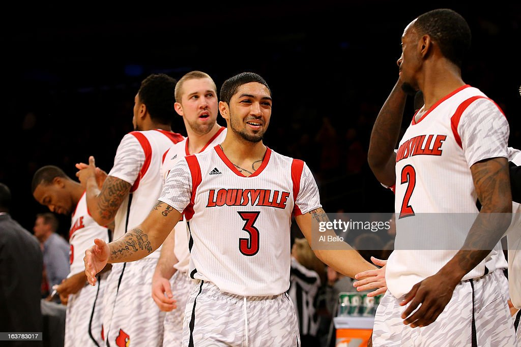 Peyton Siva #3 (C) and Russ Smith #2 (R) of the Louisville Cardinals celebrate after they won 69-57 against the Notre Dame Fighting Irish during the semifinals of the Big East Men's Basketball Tournament at Madison Square Garden on March 15, 2013 in New York City.