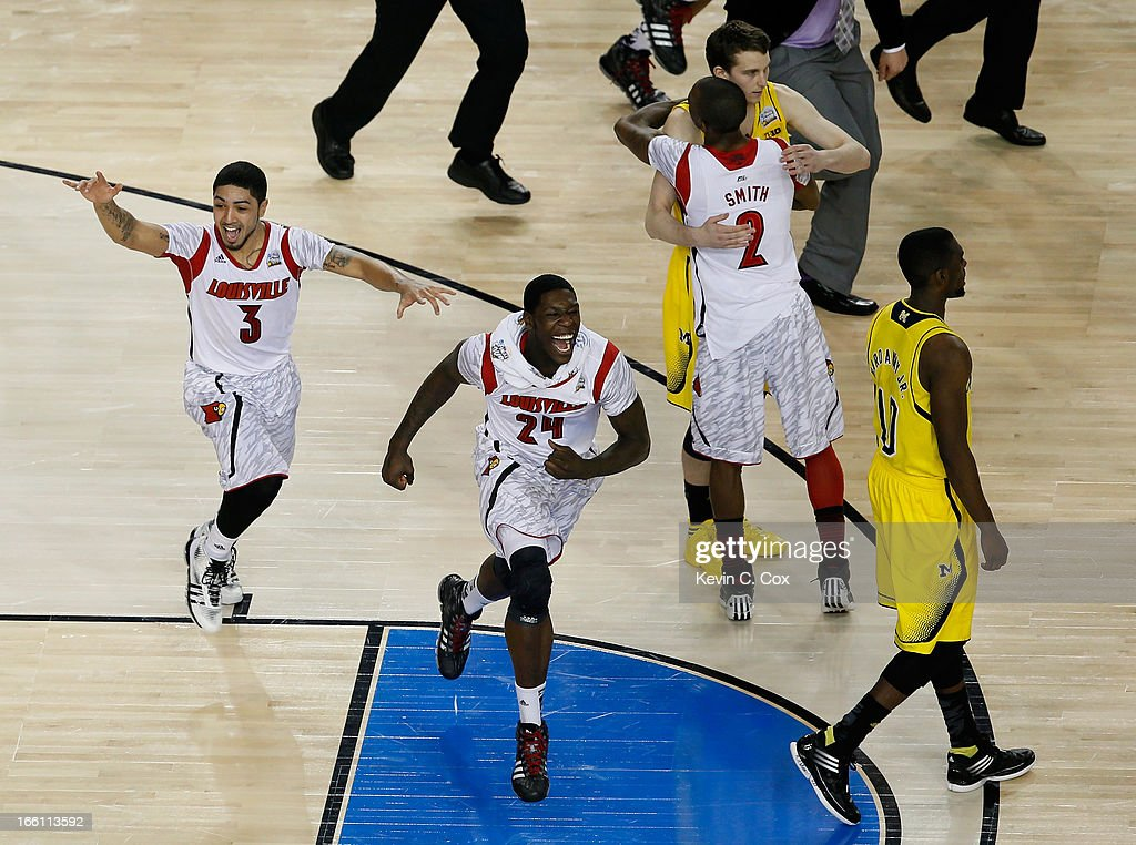 Peyton Siva #3, Montrezl Harrell #24 and Russ Smith #2 of the Louisville Cardinals celebrate after they won 82-76 against the Michigan Wolverines during the 2013 NCAA Men's Final Four Championship at the Georgia Dome on April 8, 2013 in Atlanta, Georgia.