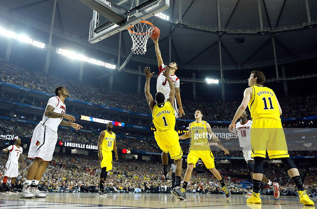 Peyton Siva #3 of the Louisville Cardinals attempts a dunk in the first half against Glenn Robinson III #1 of the Michigan Wolverines during the 2013 NCAA Men's Final Four Championship at the Georgia Dome on April 8, 2013 in Atlanta, Georgia.