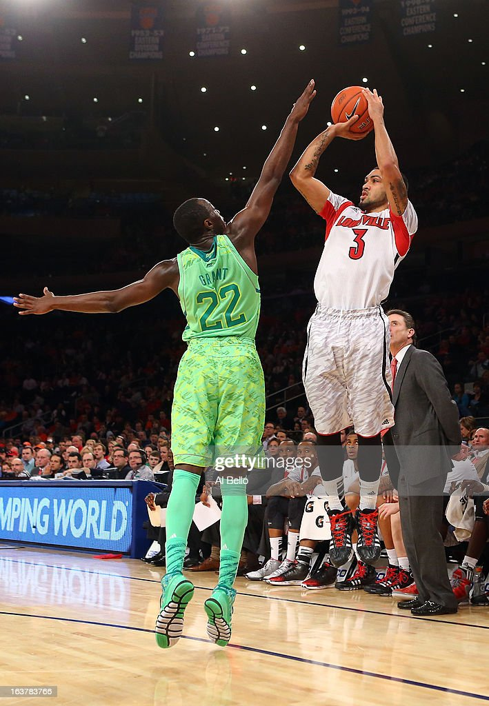 Peyton Siva #3 of the Louisville Cardinals attempts a shot against Jerian Grant #22 of the Notre Dame Fighting Irish during the semifinals of the Big East Men's Basketball Tournament at Madison Square Garden on March 15, 2013 in New York City.