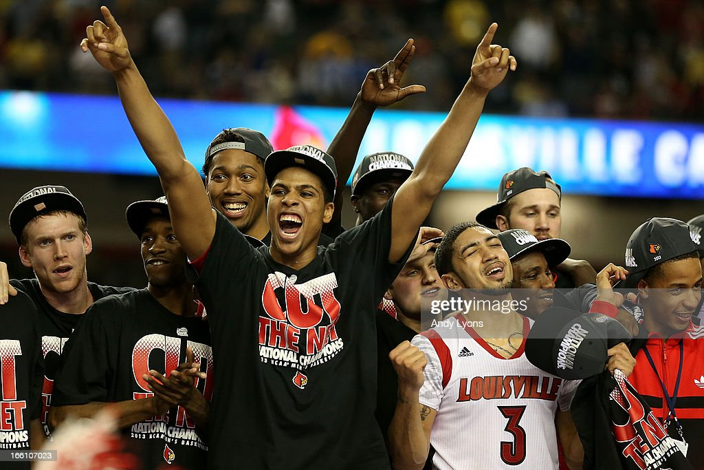 <a gi-track='captionPersonalityLinkClicked' href=/galleries/search?phrase=Peyton+Siva&family=editorial&specificpeople=5792001 ng-click='$event.stopPropagation()'>Peyton Siva</a> #3 of the Louisville Cardinals celebrate with teammates after they won 82-76 against the Michigan Wolverines during the 2013 NCAA Men's Final Four Championship at the Georgia Dome on April 8, 2013 in Atlanta, Georgia.