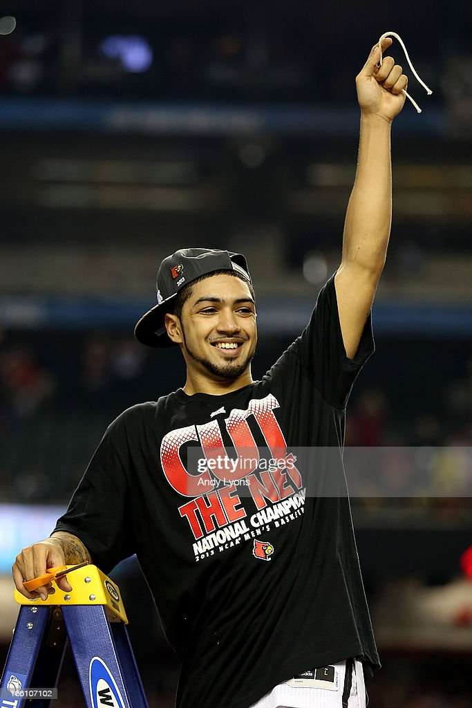 <a gi-track='captionPersonalityLinkClicked' href=/galleries/search?phrase=Peyton+Siva&family=editorial&specificpeople=5792001 ng-click='$event.stopPropagation()'>Peyton Siva</a> #3 of the Louisville Cardinals celebrates after he cut down a piece of the net after they won 82-76 against the Michigan Wolverines during the 2013 NCAA Men's Final Four Championship at the Georgia Dome on April 8, 2013 in Atlanta, Georgia.