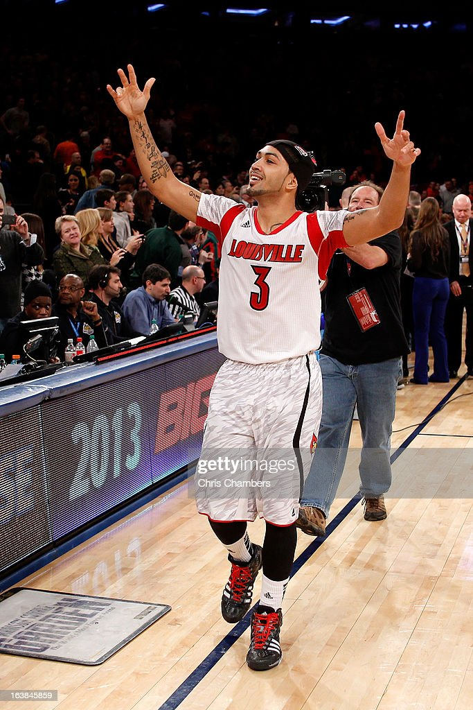 <a gi-track='captionPersonalityLinkClicked' href=/galleries/search?phrase=Peyton+Siva&family=editorial&specificpeople=5792001 ng-click='$event.stopPropagation()'>Peyton Siva</a> #3 of the Louisville Cardinals celebrates after they won 78-61 against the Syracuse Orange during the final of the Big East Men's Basketball Tournament at Madison Square Garden on March 16, 2013 in New York City.