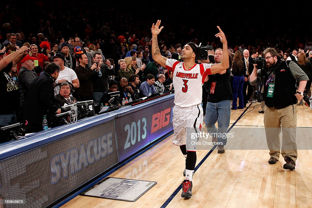 Peyton Siva #3 of the Louisville Cardinals celebrates after they won 78-61 against the Syracuse Orange during the final of the Big East Men's Basketball Tournament at Madison Square Garden on March 16, 2013 in New York City.