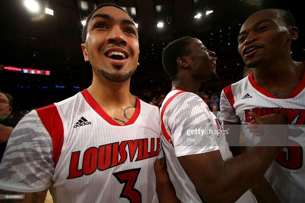 Peyton Siva #3 (L) of the Louisville Cardinals celebrates after they won 78-61 against the Syracuse Orange during the final of the Big East Men's Basketball Tournament at Madison Square Garden on March 16, 2013 in New York City.
