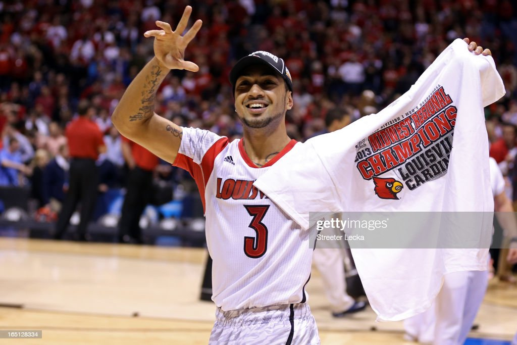 Peyton Siva #3 of the Louisville Cardinals celebrates on court after they won 85-63 against the Duke Blue Devils during the Midwest Regional Final round of the 2013 NCAA Men's Basketball Tournament at Lucas Oil Stadium on March 31, 2013 in Indianapolis, Indiana.