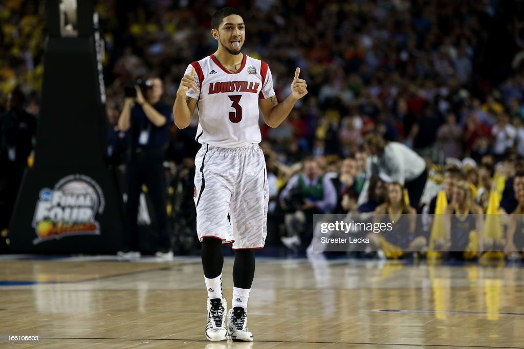 <a gi-track='captionPersonalityLinkClicked' href=/galleries/search?phrase=Peyton+Siva&family=editorial&specificpeople=5792001 ng-click='$event.stopPropagation()'>Peyton Siva</a> #3 of the Louisville Cardinals celebrates their 82-76 win against the Michigan Wolverines during the 2013 NCAA Men's Final Four Championship at the Georgia Dome on April 8, 2013 in Atlanta, Georgia.