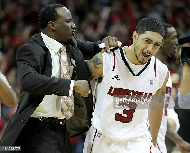 Peyton Siva of the Louisville Cardinals celebrates with program assistant Andre McGee after Sosa hit the winning shot in overtime to beat the...