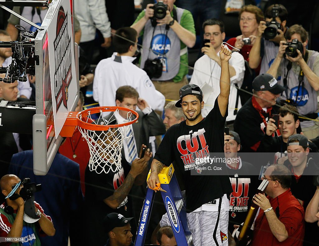 Peyton Siva #3 of the Louisville Cardinals cuts down a piece of the net as he celebrates their 82-76 win against the Michigan Wolverines during the 2013 NCAA Men's Final Four Championship at the Georgia Dome on April 8, 2013 in Atlanta, Georgia.