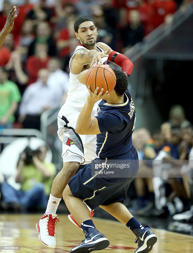 <a gi-track='captionPersonalityLinkClicked' href=/galleries/search?phrase=Peyton+Siva&family=editorial&specificpeople=5792001 ng-click='$event.stopPropagation()'>Peyton Siva</a> #3 of the Louisville Cardinals defends James Robinson #0 of the Pittsburgh Panthers during the game at KFC YUM! Center on January 28, 2013 in Louisville, Kentucky.