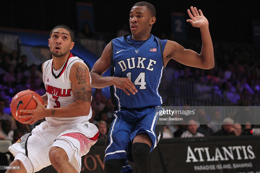 <a gi-track='captionPersonalityLinkClicked' href=/galleries/search?phrase=Peyton+Siva&family=editorial&specificpeople=5792001 ng-click='$event.stopPropagation()'>Peyton Siva</a> #3 of the Louisville Cardinals dribbles against Rasheed Sulaimon #14 of the Duke Blue Devils during the Battle 4 Atlantis tournament at Atlantis Resort November 24, 2012 in Nassau, Paradise Island, Bahamas.
