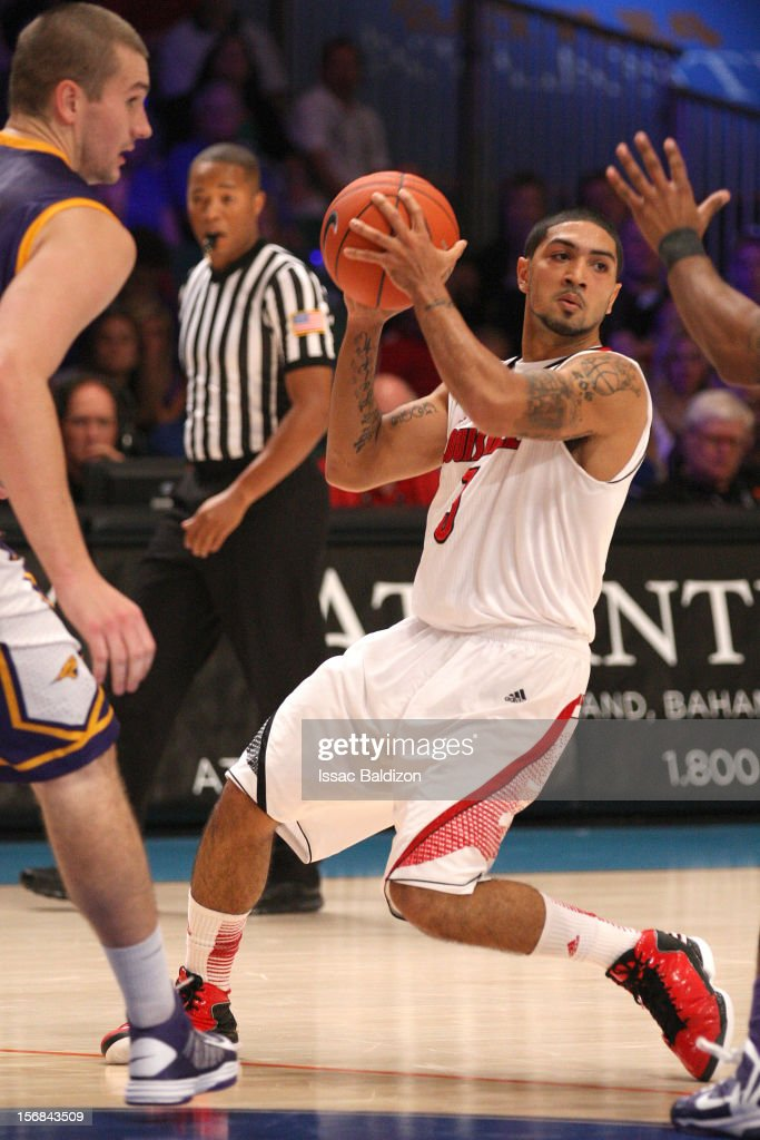 <a gi-track='captionPersonalityLinkClicked' href=/galleries/search?phrase=Peyton+Siva&family=editorial&specificpeople=5792001 ng-click='$event.stopPropagation()'>Peyton Siva</a> #3 of the Louisville Cardinals dribbles against the Northern Iowa Panthers during the Battle 4 Atlantis tournament at Atlantis Resort on November 22, 2012 in Nassau, Paradise Island, Bahamas.