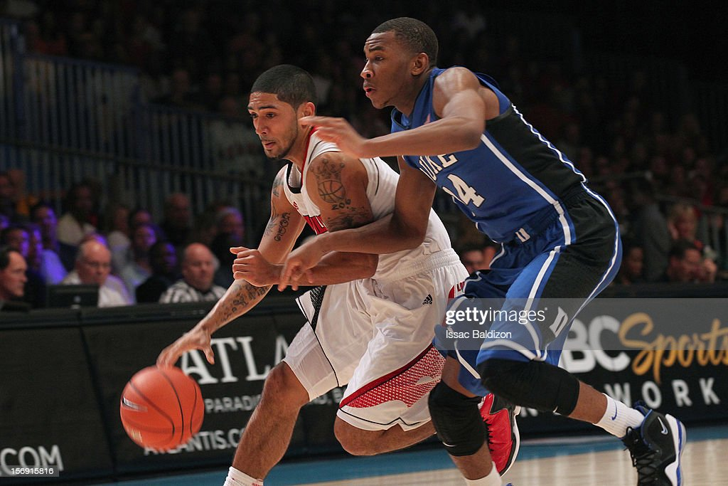 <a gi-track='captionPersonalityLinkClicked' href=/galleries/search?phrase=Peyton+Siva&family=editorial&specificpeople=5792001 ng-click='$event.stopPropagation()'>Peyton Siva</a> #3 of the Louisville Cardinals drives against Rasheed Sulaimon #14 of the Duke Blue Devils during the Battle 4 Atlantis tournament at Atlantis Resort November 24, 2012 in Nassau, Paradise Island, Bahamas.