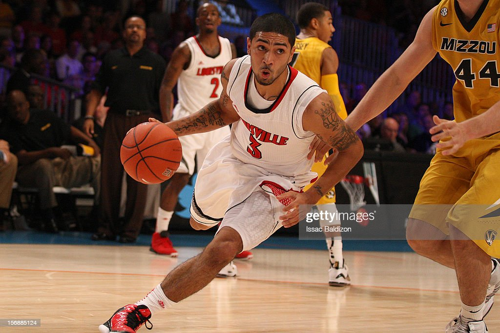 <a gi-track='captionPersonalityLinkClicked' href=/galleries/search?phrase=Peyton+Siva&family=editorial&specificpeople=5792001 ng-click='$event.stopPropagation()'>Peyton Siva</a> #3 of the Louisville Cardinals drives against Ryan Rosburg #44 of the Missouri Tigers during the Battle 4 Atlantis tournament at Atlantis Resort November 23, 2012 in Nassau, Paradise Island, Bahamas.