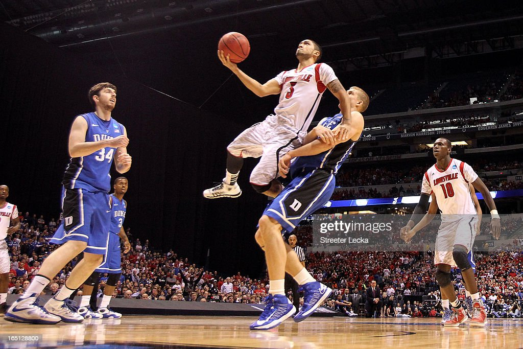 <a gi-track='captionPersonalityLinkClicked' href=/galleries/search?phrase=Peyton+Siva&family=editorial&specificpeople=5792001 ng-click='$event.stopPropagation()'>Peyton Siva</a> #3 of the Louisville Cardinals drives for a shot attempt against <a gi-track='captionPersonalityLinkClicked' href=/galleries/search?phrase=Mason+Plumlee&family=editorial&specificpeople=5792012 ng-click='$event.stopPropagation()'>Mason Plumlee</a> #5 of the Duke Blue Devils during the Midwest Regional Final round of the 2013 NCAA Men's Basketball Tournament at Lucas Oil Stadium on March 31, 2013 in Indianapolis, Indiana.