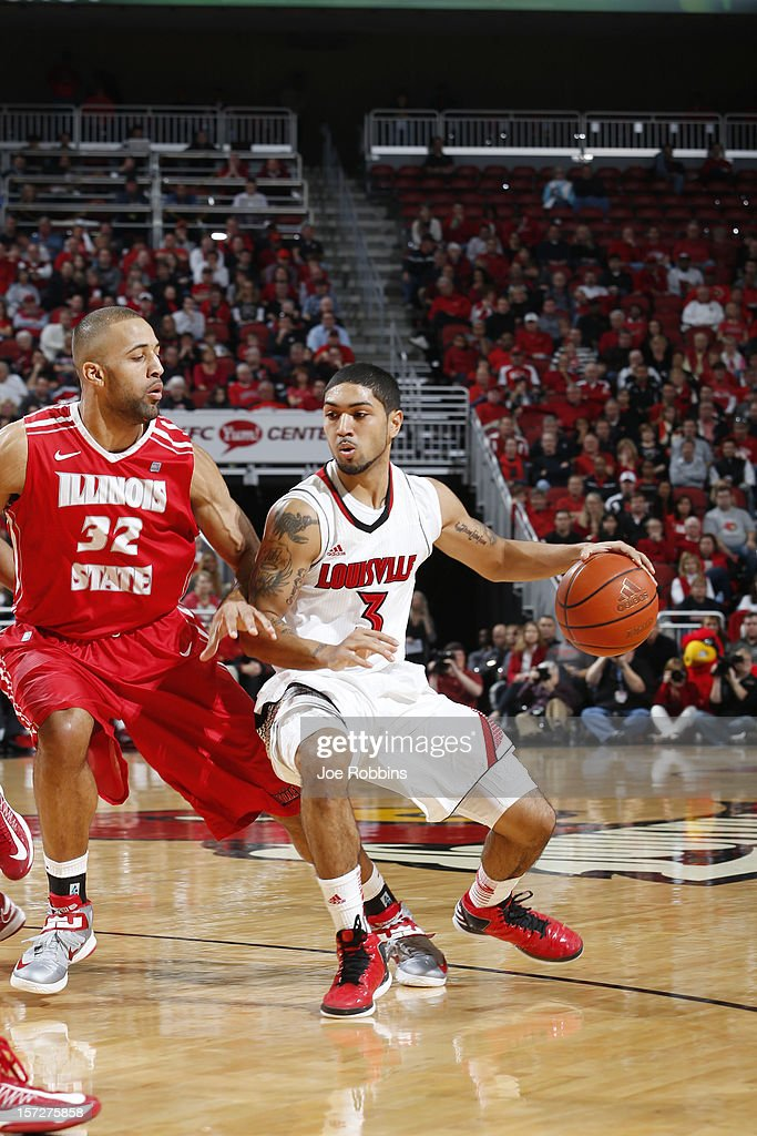 <a gi-track='captionPersonalityLinkClicked' href=/galleries/search?phrase=Peyton+Siva&family=editorial&specificpeople=5792001 ng-click='$event.stopPropagation()'>Peyton Siva</a> #3 of the Louisville Cardinals drives to the basket against Jackie Carmichael #32 of the Illinois State Redbirds during the game at KFC Yum! Center on December 1, 2012 in Louisville, Kentucky. Louisville won 69-66.