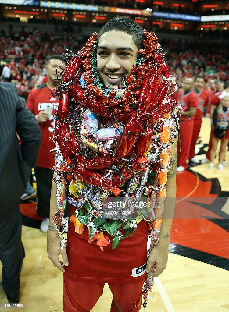Peyton Siva #3 of the Louisville Cardinals is overwhelmed with leis following the game against the Notre Dame Fighting Irish at KFC YUM! Center on March 9, 2013 in Louisville, Kentucky.