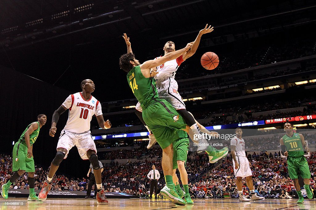 <a gi-track='captionPersonalityLinkClicked' href=/galleries/search?phrase=Peyton+Siva&family=editorial&specificpeople=5792001 ng-click='$event.stopPropagation()'>Peyton Siva</a> #3 of the Louisville Cardinals loses the ball as he drives in the second half against <a gi-track='captionPersonalityLinkClicked' href=/galleries/search?phrase=Arsalan+Kazemi&family=editorial&specificpeople=5952788 ng-click='$event.stopPropagation()'>Arsalan Kazemi</a> #14 of the Oregon Ducks during the Midwest Region Semifinal round of the 2013 NCAA Men's Basketball Tournament at Lucas Oil Stadium on March 29, 2013 in Indianapolis, Indiana.