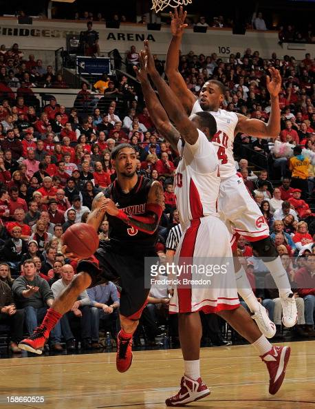 Peyton Siva of the Louisville Cardinals passes the ball against the Western Kentucky Hilltoppers at Bridgestone Arena on December 22 2012 in...