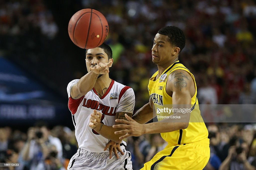 Peyton Siva #3 of the Louisville Cardinals passes the ball against Trey Burke #3 of the Michigan Wolverines in the second half during the 2013 NCAA Men's Final Four Championship at the Georgia Dome on April 8, 2013 in Atlanta, Georgia.