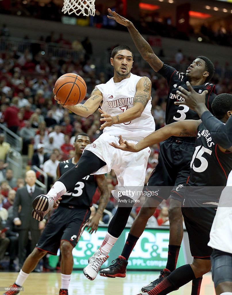 Peyton Siva #3 of the Louisville Cardinals passes the ball during the game against the Cincinnati Bearcats at KFC YUM! Center on March 4, 2013 in Louisville, Kentucky.