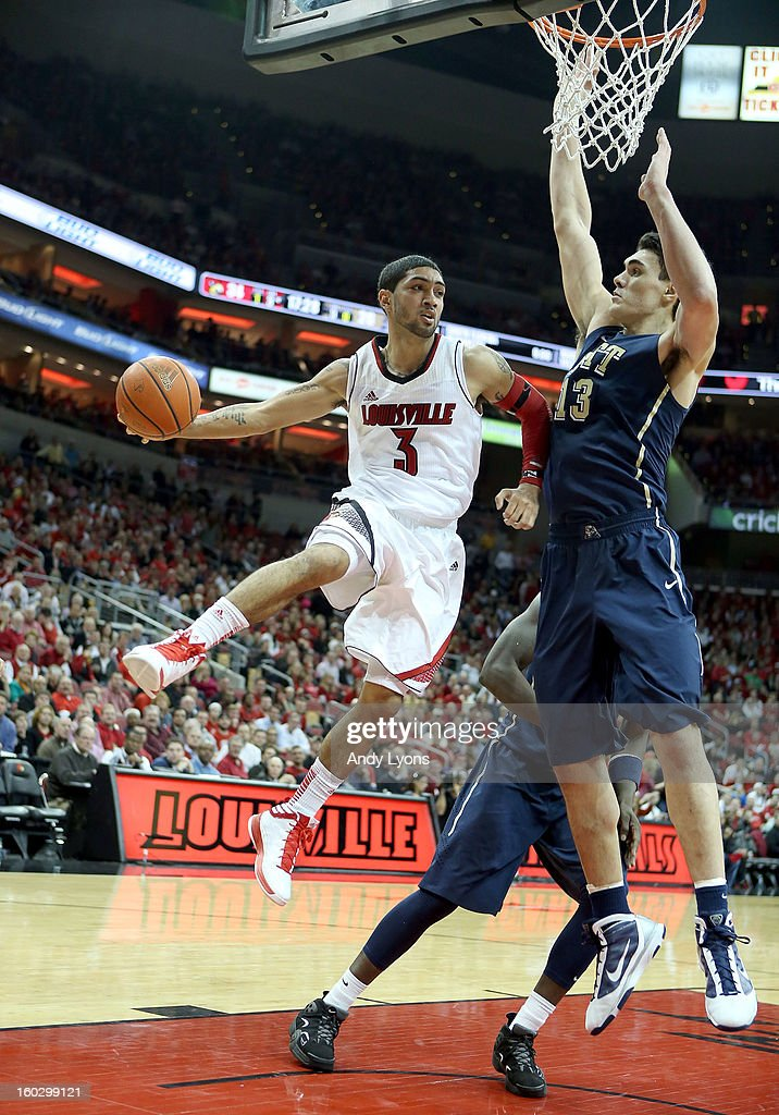 <a gi-track='captionPersonalityLinkClicked' href=/galleries/search?phrase=Peyton+Siva&family=editorial&specificpeople=5792001 ng-click='$event.stopPropagation()'>Peyton Siva</a> #3 of the Louisville Cardinals passes the ball while defended by Steven Adams #13 of the Pittsburgh Panthers during the game at KFC YUM! Center on January 28, 2013 in Louisville, Kentucky.