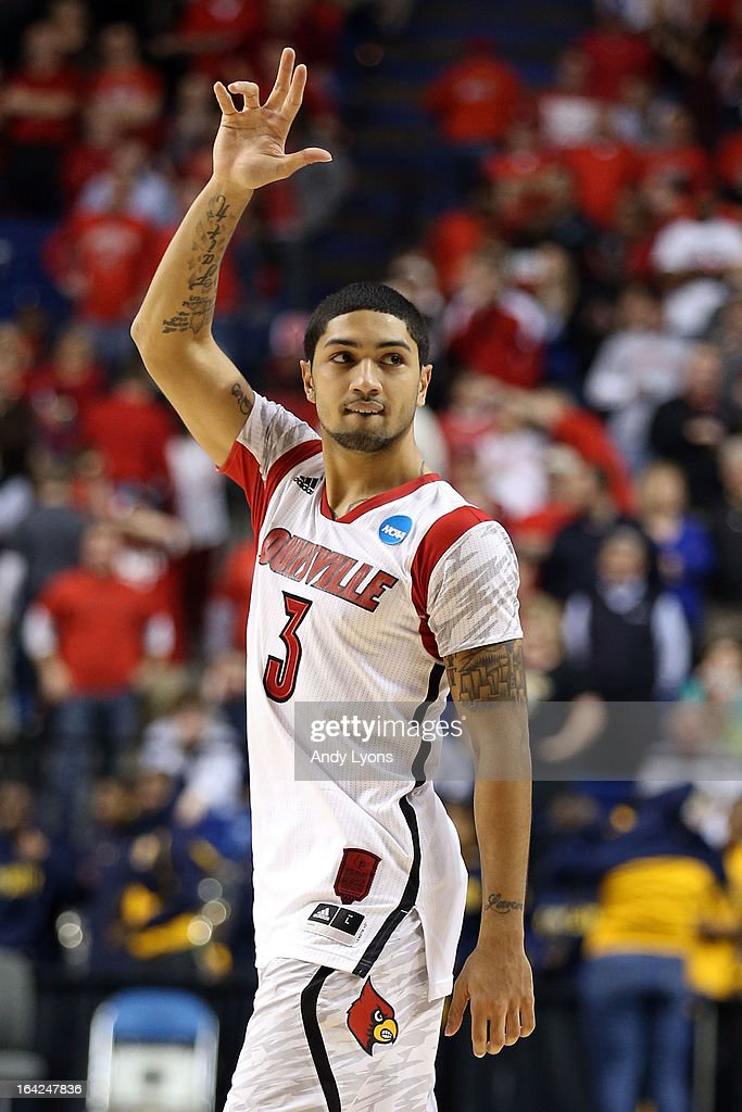<a gi-track='captionPersonalityLinkClicked' href=/galleries/search?phrase=Peyton+Siva&family=editorial&specificpeople=5792001 ng-click='$event.stopPropagation()'>Peyton Siva</a> #3 of the Louisville Cardinals reacts after defeating the North Carolina A&T Aggies during the second round of the 2013 NCAA Men's Basketball Tournament at the Rupp Arena on March 21, 2013 in Lexington, Kentucky.