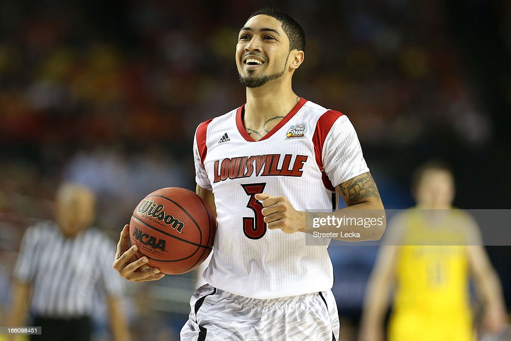 <a gi-track='captionPersonalityLinkClicked' href=/galleries/search?phrase=Peyton+Siva&family=editorial&specificpeople=5792001 ng-click='$event.stopPropagation()'>Peyton Siva</a> #3 of the Louisville Cardinals reacts in the second half against the Michigan Wolverines during the 2013 NCAA Men's Final Four Championship at the Georgia Dome on April 8, 2013 in Atlanta, Georgia.