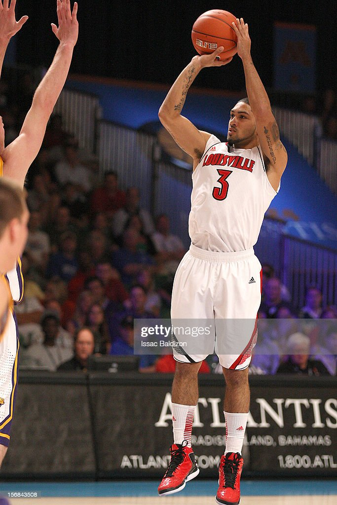 <a gi-track='captionPersonalityLinkClicked' href=/galleries/search?phrase=Peyton+Siva&family=editorial&specificpeople=5792001 ng-click='$event.stopPropagation()'>Peyton Siva</a> #3 of the Louisville Cardinals shoots against the Northern Iowa Panthers during the Battle 4 Atlantis tournament at Atlantis Resort on November 22, 2012 in Nassau, Paradise Island, Bahamas.