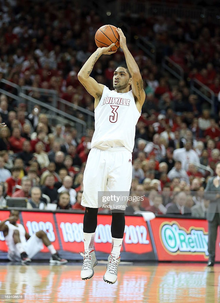 Peyton Siva #3 of the Louisville Cardinals shoots the ball during the game against the Cincinnati Bearcats at KFC YUM! Center on March 4, 2013 in Louisville, Kentucky.