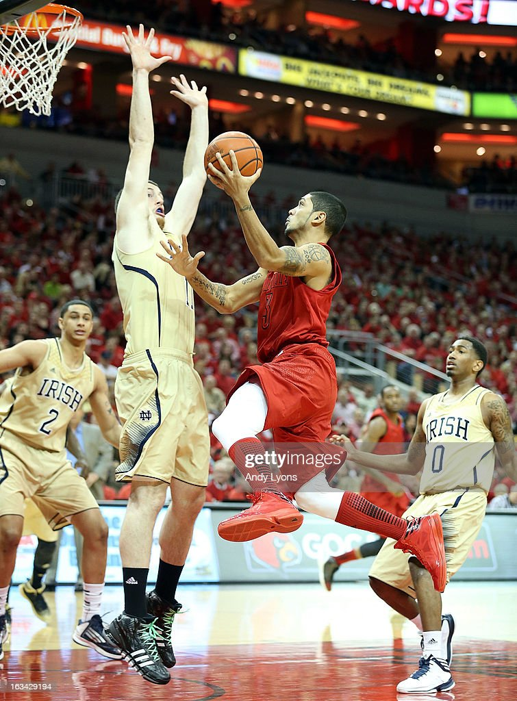 Peyton Siva #3 of the Louisville Cardinals shoots the ball during the game against the Notre Dame Fighting Irish at KFC YUM! Center on March 9, 2013 in Louisville, Kentucky.