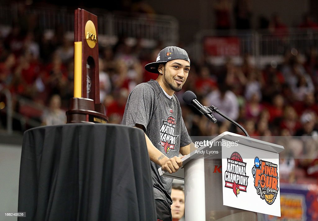 Peyton Siva of the Louisville Cardinals speaks during the Louisville Cardinals NCAA Basketball Celebration to mark the NCAA championship by the Mens team and the runner-up finish by the womens team at KFC YUM! Center on April 10, 2013 in Louisville, Kentucky.