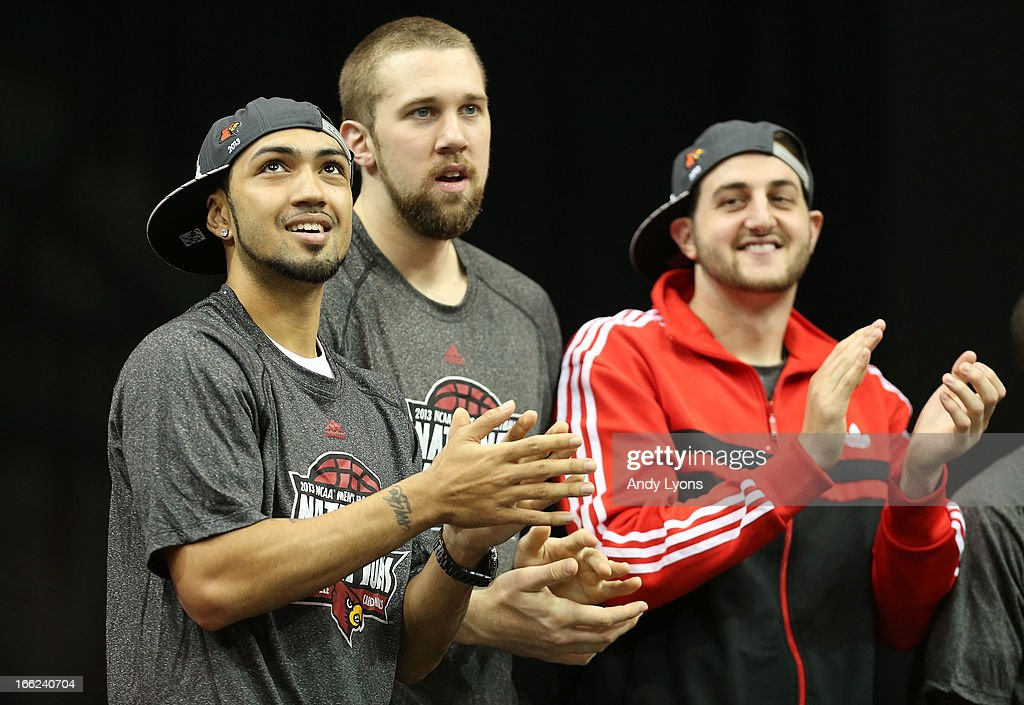 Peyton Siva, Stephan Van Treese and Mike Marra of the Louisville Cardinals watch a video presentation during the Louisville Cardinals NCAA Basketball Celebration to mark the NCAA championship by the Mens team and the runner-up finish by the womens team at KFC YUM! Center on April 10, 2013 in Louisville, Kentucky.