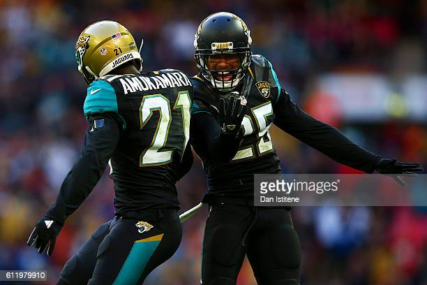 Peyton Thompson of the Jacksonville Jaguars celebrates victory with teammate Prince Amukamara after the NFL game between Indianapolis Colts and...