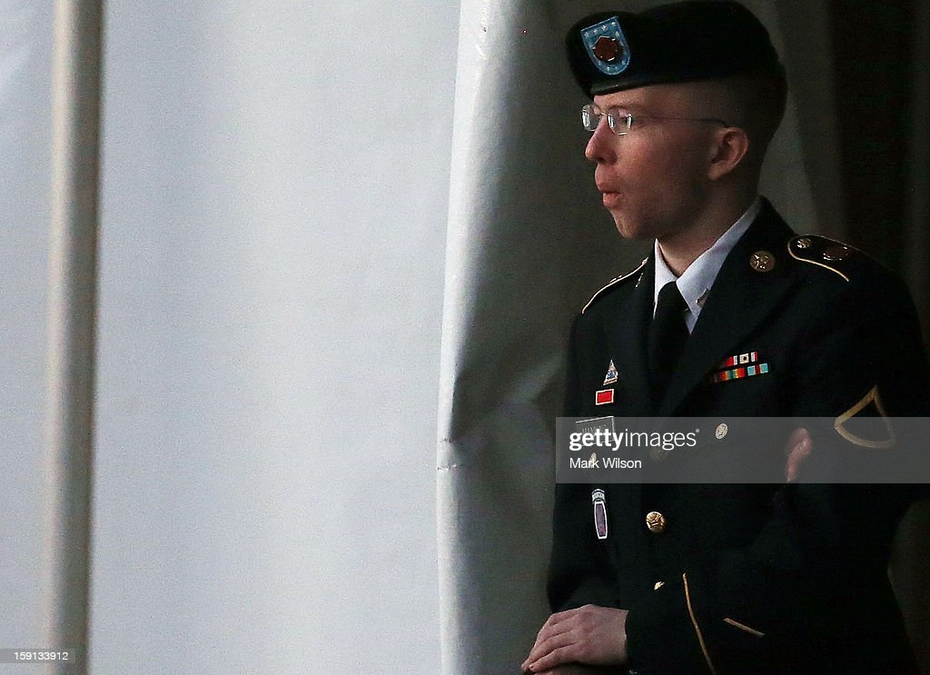 Pfc. Bradley E. Manning is escorted from a hearing, on January 8, 2013 in Fort Meade, Maryland. Manning attended a motion hearing in the case of United States vs. Pfc. Bradley E. Manning, who is charged with aiding the enemy and wrongfully causing intelligence to be published on the internet. He is accused of sending hundreds of thousands of classified Iraq and Afghanistan war logs and more than 250,000 diplomatic cables to the website WikiLeaks while he was working as an intelligence analyst in Baghdad in 2009 and 2010.