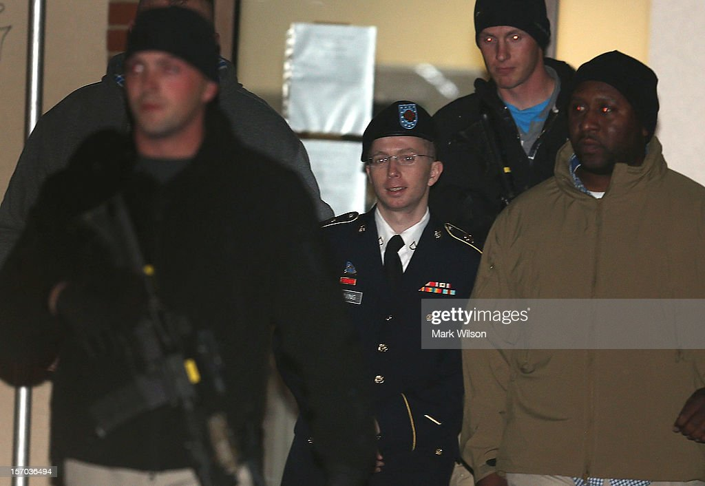 Pfc. Bradley E. Manning is escorted from a hearing, on November 27, 2012 in Fort Meade, Maryland. Manning attended a motion hearing in the case of United States vs. Pfc. Bradley E. Manning, who is charged with aiding the enemy and wrongfully causing intelligence to be published on the internet. He is accused of sending hundreds of thousands of classified Iraq and Afghanistan war logs and more than 250,000 diplomatic cables to the website WikiLeaks while he was working as an intelligence analyst in Baghdad in 2009 and 2010.