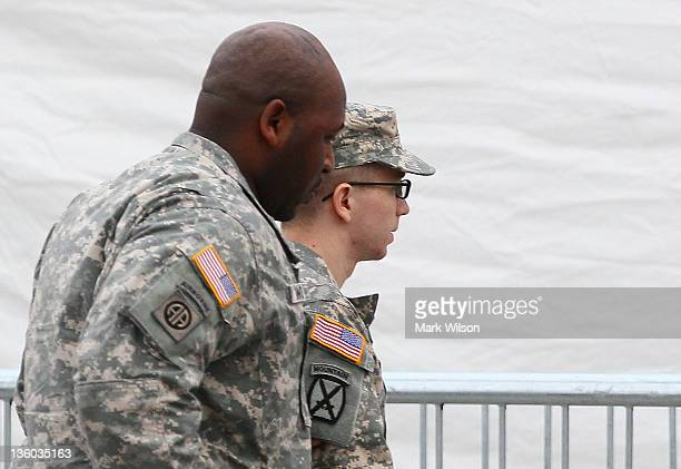 Pfc Bradley Manning is escorted into a building to attend the second day of his Article 32 hearing on December 17 2011 in Fort Meade Maryland Pfc...