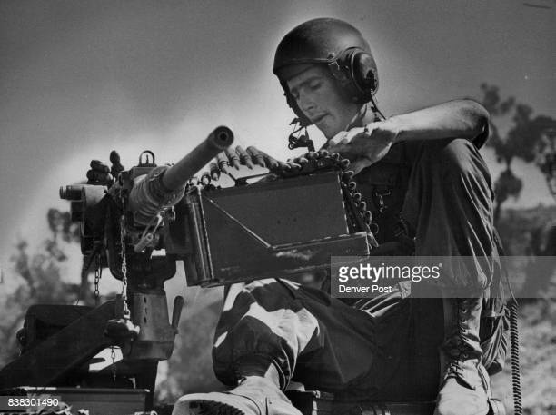 Pfc Stan Kenned Portland Ore loads the 50caliber machine gun atop the vehicle Sheridan is lighter than a tank Credit Denver Post