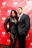 Phaedra Parks and husband Apollo Nida from Bravo's 'Real Housewives Of Atlanta' poses for red carpet photos for 'A Mother's Love' stage play at the...