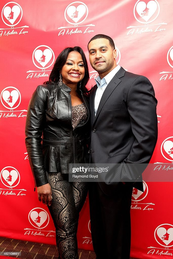 Phaedra Parks and husband Apollo Nida from Bravo's 'Real Housewives Of Atlanta', poses for red carpet photos for 'A Mother's Love' stage play at the Rialto Center For The Arts in Atlanta, Georgia on NOVEMBER