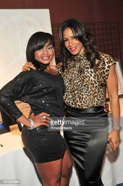 Phaedra Parks and Sheree Whitfield attend Ted Turner's Captain Planet Cartoon 20th Birthday benefit at the Georgia Aquarium on December 10 2010 in...