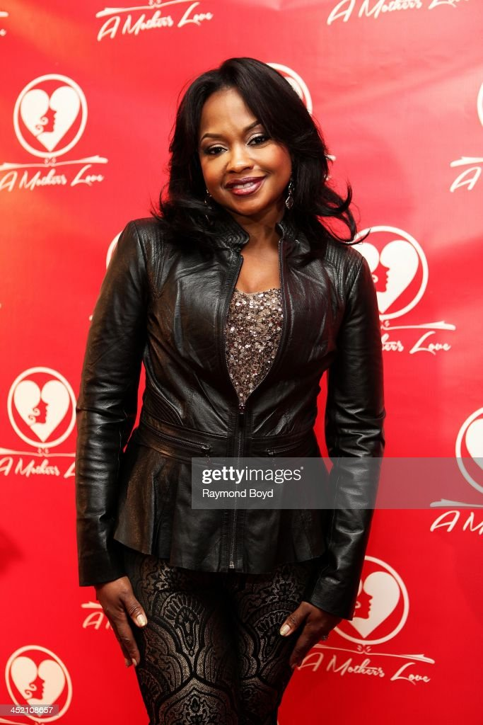 Phaedra Parks from Bravo's 'Real Housewives Of Atlanta', poses for red carpet photos for 'A Mother's Love' stage play at the Rialto Center For The Arts in Atlanta, Georgia on NOVEMBER