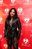 Phaedra Parks from Bravo's 'Real Housewives Of Atlanta' poses for red carpet photos for 'A Mother's Love' stage play at the Rialto Center For The...