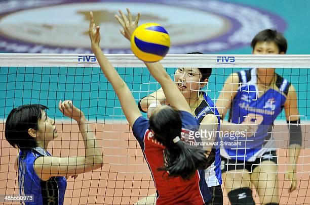Pham Thi Thu Trang of Thon Tin Lienvietpostbanl block Iwasaka Nana of Hisamitsu spike during the FIVB 17th Princess Cup Asian Women's Cup Volleyball...